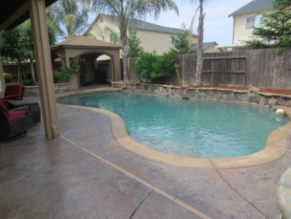 This is an image of a pool deck by a Tracy pool deck contractor