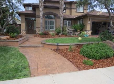 This is an image of stamped concrete driveway Tracy